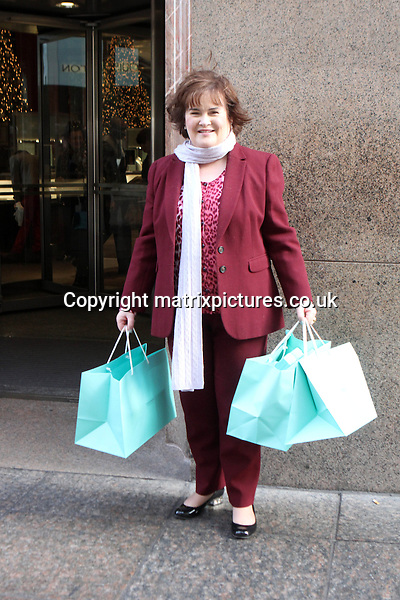 "EXCLUSIVE PICTURE: MATRIXPICTURES.CO.UK.PLEASE CREDIT ALL USES..UK, AUSTRALIA, NEW ZEALAND AND ASIA RIGHTS ONLY..*** EXCLUSIVE FEES TO BE AGREED BEFORE USE ***..Scottish ""Britain's Got Talent"" pop singer Susan Boyle is pictured on a visit to New York. She takes time off from promoting her new ""Standing Ovations"" album for a quick sight-seeing trip and a shopping spree in the Big Apple. Susan is recognised by fans all day, who request photographs with the star...Susan and a few close friends leave their hotel and take a tour in a horse drawn carriage around Central Park. They end the afternoon with some retail therapy at Tiffany & Co, where she splashes out £12,000 on presents for family and Simon Cowell! Boyle is now estimated to be worth £14 million. ..NOVEMBER 13th 2012..REF: MTX 125246..Mueller"