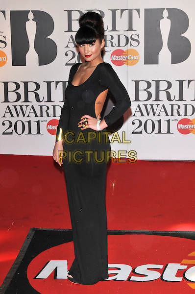 YASMIN .The BRIT Awards 2011 - Arrivals at the O2 Arena, London, England, UK, .February 15th, 2011..brits full length black dress hand on hip long sleeve maxi cut out side away tattoo gold cuff ring .CAP/PL.©Phil Loftus/Capital Pictures.
