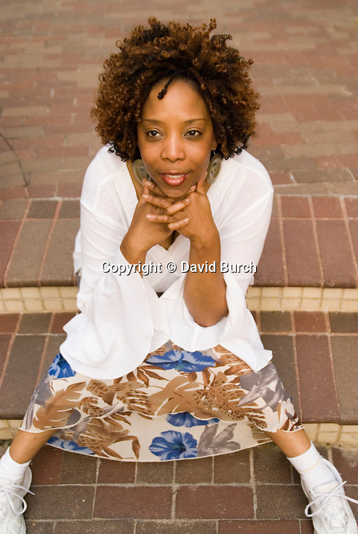 African American woman sitting and contemplating