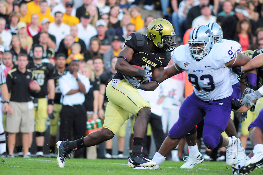 18 October 08: Colorado running back Darrell Scott rushes against Kansas State. On the play is Kansas State defensive tackle Gabriel Crews (93). The Colorado Buffaloes defeated the Kansas State Wildcats 14-13 at Folsom Field in Boulder, Colorado.