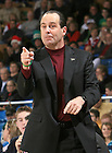 Notre Dame Fighting Irish head coach Mike Brey signals to his team.