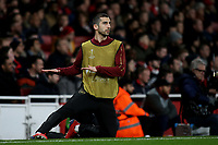 Henrkh Mkhitaryan of Arsenal warms up on the touchline ahead of coming as a second half substitute during Arsenal vs Rennes, UEFA Europa League Football at the Emirates Stadium on 14th March 2019