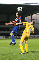 Anton Brady heads over Dale Shirkin in the St Mirren v Motherwell Clydesdale Bank Scottish Premier League U20 match played at St Mirren Park, Paisley on 10.9.12..