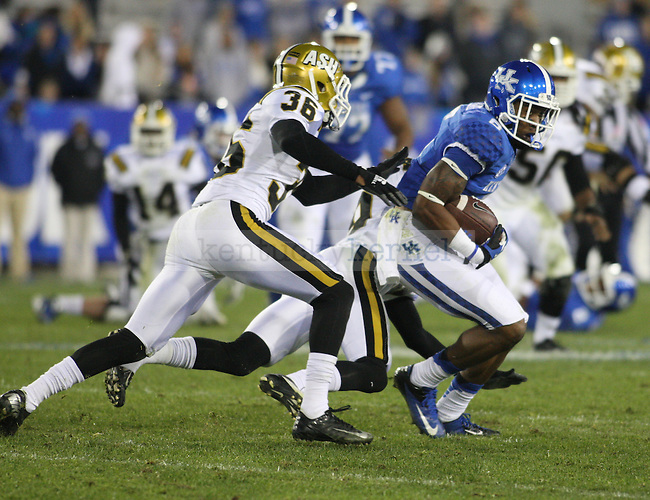 UK wide receiver A.J. Legree (6) runs the ball against Alabama State defense during the University of Kentucky Homecoming football game against Alabama State at Commonwealth Stadium in Lexington, Ky., on Saturday, November 2, 2013. Photo by Tessa Lighty | Staff