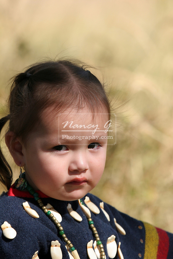 Young Native American Girl on the South Dakota Reservation dressed up in traditional clothes.