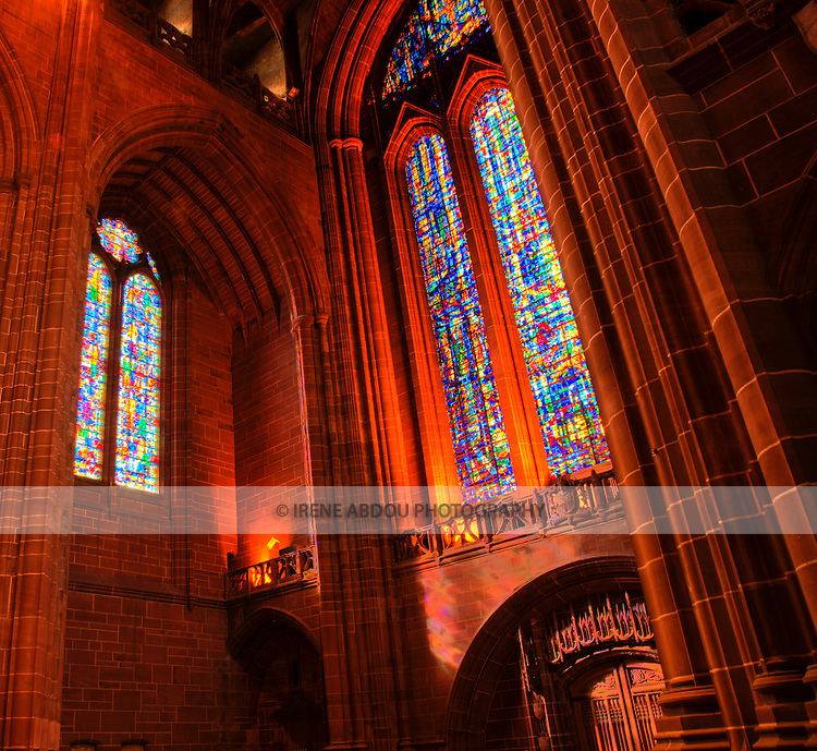 High dynamic range (HDR) imaging shows off the intricate interior architecture as well as the detail of this stained glass window in the Roman Catholic Metropolitan Cathedral of Liverpool in England's 5th most populous city.  One of the tallest cathedrals in the world, it rises up to 100 meters high and is a popular and beautiful destination for tourists to the city.