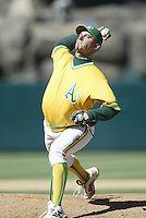 Billy Koch of the Oakland Athletics pitches during a 2002 MLB season game against the Los Angeles Angels at Angel Stadium, in Anaheim, California. (Larry Goren/Four Seam Images)