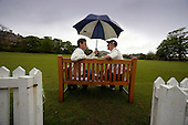 Scottish National Cricket League - with the league programme all but washed out for the day, Carlton's Scottish-born pro Ross Lyons (left) discusses the weather with Ayr captain Phil Wilson, at Grange Loan, Edinburgh - Picture by Donald MacLeod - 9 May 2009