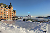Ice skating rink on the Dufferin Terrace overlooking the Saint Lawrence river, at the Chateau Frontenac, opened 1893, designed by Bruce Price as a chateau style hotel for the Canadian Pacific Railway company or CPR, in Quebec City, Quebec, Canada. The building was extended and the central tower added in 1924, by William Sutherland Maxwell. The building is now a hotel, the Fairmont Le Chateau Frontenac, and is listed as a National Historic Site of Canada. The Historic District of Old Quebec is listed as a UNESCO World Heritage Site. Picture by Manuel Cohen