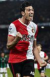 Nederland, Rotterdam, 23 december  2012.Eredivisie.Seizoen 2012/2013.Feyenoord-FC Groningen.Graziano Pelle van Feyenoord gaat uit zijn dak na het scoren van de 2-1