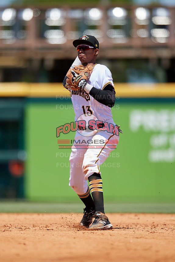 Bradenton Marauders shortstop Alfredo Reyes (13) throws to first base during a game against the Charlotte Stone Crabs on April 9, 2017 at LECOM Park in Bradenton, Florida.  Bradenton defeated Charlotte 5-0.  (Mike Janes/Four Seam Images)