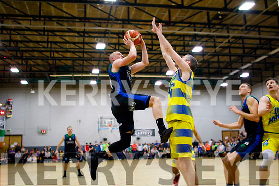 Kieran Donaghy lets fly during the game between Garveys Tralee Warriors and UCD Marian at the Tralee sports complex last Saturday night.