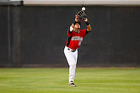 Center fielder Teodoro Martinez #4 of the Hickory Crawdads makes a catch against the Augusta GreenJackets at L.P. Frans Stadium on April 29, 2011 in Hickory, North Carolina.   Photo by Brian Westerholt / Four Seam Images