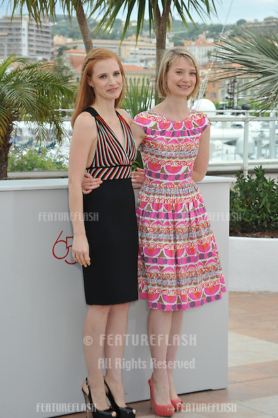 """Jessica Chastain & Mia Wasikowska (right) at the photocall for her new movie """"Lawless"""", in competition at the 65th Festival de Cannes..May 19, 2012  Cannes, France.Picture: Paul Smith / Featureflash"""