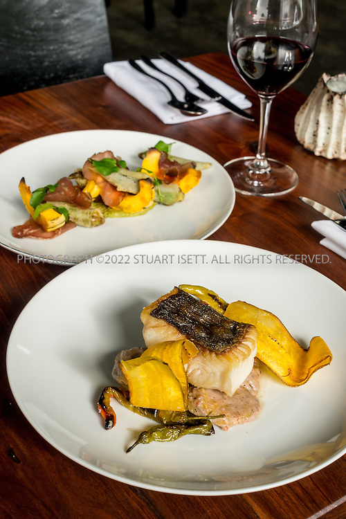 10/23/2015&mdash;Seattle, WA, USA<br /> <br /> Salare restaurant, owned by chef Edouardo Jordan, who is originally from St. Petersburg, Florida. <br /> <br /> Shown here: &ldquo;Black cod &ldquo;Run Down&rdquo;, made with Black cod from the Makah tribe in Neah Bay, Washington, plantains, sweet corn, fushimi peppers, coconut milk and tostones. <br /> <br /> Behind is a a salad made with delicate squash, Asian pears, breasola, okra and egusi sauce with water cress.<br /> <br /> Salare is a chef-driven neighborhood restaurant, in the Ravenna neighborhood in North Seattle, that captures America&rsquo;s diverse culture of food with influences from America&rsquo;s South, Africa, Europe and the Caribbean Islands.<br /> <br /> Photograph by Stuart Isett<br /> &copy;2015 Stuart Isett. All rights reserved.