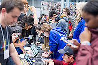 Workers from Google interact with visitors at a Career Expo held at the FIRST Robotics NYC Championship at the Jacob Javits Convention Center in New York on Sunday, March 13, 2016. The expo enables participants to speak with companies and professional organizations giving a real-world look into science and technology as used in the business world and their career opportunities. (© Richard B. Levine)