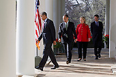 United States President Barack Obama, left, walks out of the Oval Office with Jim Yong Kim, president of Dartmouth College and nominee to become president of the World Bank, center, U.S. Secretary of State Hillary Rodham Clinton, Hillary Clinton, and U.S. Secretary of the Treasury Timothy Geithner, to make a speech in the Rose Garden of the White House in Washington, D.C., U.S., on Friday, March 23, 2012. Kim was born in Seoul and is a U.S. citizen. He would succeed Robert Zoellick as the head of the bank. The bank made $57 billion loans in the last fiscal year..Credit: Andrew Harrer / Pool via CNP
