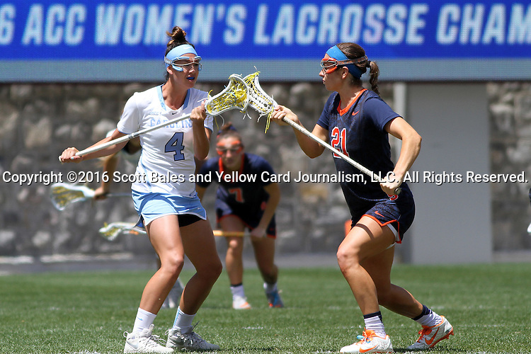 01 May 2016: North Carolina's Marie McCool (4) and Syracuse's Kayla Treanor (21) challenge for a draw. The University of North Carolina Tar Heels played the Syracuse University Orange at Lane Stadium in Blacksburg, Virginia in the 2016 Atlantic Coast Conference Women's Lacrosse Tournament championship match. North Carolina won 15-14 in overtime.