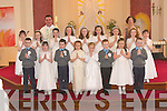 COMMUNION: The Tarbert First Holy Communion Class with Fr Francis Nolan PP and Rosaleen Geoghegan their teacher in St Mary'S Church Tarbert on Saturday. Photographed front l-r: Paul Styles, Rachael Moriarty, Daragh Kissane, Muirne Wall, Megan Costello, Aaron Conway, Caitri?ona Fitzmaurice and Robert Rowley. Back l-r: Sine?ad McKenna, Mairead Spaight, Sarah Hagan, Alannah Brent, Laura McLoughlin, Gra?inne Heaphy, Caoimhe Walsh, Aisling O'Carroll and Ciara Mahony.   Copyright Kerry's Eye 2008