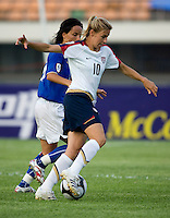 USWNT midfielder (10) Aly Wagner sprints alongside Italy's (10) Tatiana Zorri during the last group stage game at the Peace Queen Cup.  The USWNT defeated Italy, 2-0, at the Suwon Sports Center in Suwon, South Korea.