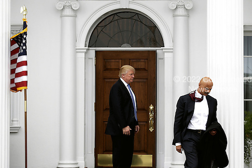 United States President-elect Donald Trump (C) sees off Peter Kirsanow at the clubhouse of Trump International Golf Club, in Bedminster Township, New Jersey, USA, 20 November 2016.<br /> Credit: Peter Foley / Pool via CNP