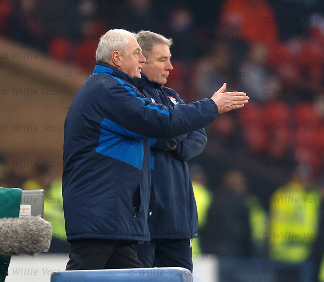 Walter Smith comes down the steps to offer hands on advice to Super Ally