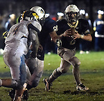 (Lexington MA 10/28/16) Lexington quarterback 8, James Lane, looks for an open man as he connects for a touchdown pass, during the first half, Friday, Oct 28, 2016, at Lexington High School. (Jim Michaud / Journal Inquirer)