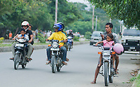 Families on motorcycles are a common sight in Dili, Timor-Leste (East Timor)