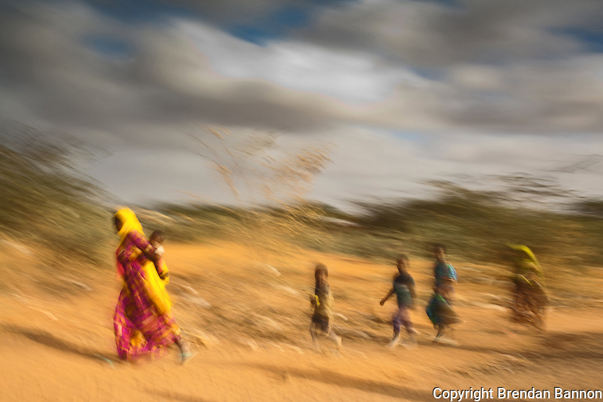 Kenya/Somali refugees.  A Somali refugee family walking on the outskirts of Ifo camp near Dadaab in Kenya. Over 40,000 Somali refugees have arrived to the three camps between June and July of 2011. The three camps in the area, first opened for 90,000 in the early 1990s today have a total population of approximately 440,000 refugees. UNHCR/ Brendan Bannon/ August 2011