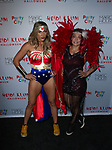 Guests arrive at Heidi Klum's 18th Annual Halloween Party presented by Party City and SVEDKA Vodka at Magic Hour Rooftop Bar & Lounge at Moxy Times Square, on October 31, 2017.