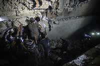 In this Sunday, Sep. 22, 2013 photo, Syrian villagers struggle for removing the debris of a shattered bulding as they attempt to rescue the members of one family, victims of an airstrike, after a helicopter dropped a bomb over Al Havit, a village located few kilometers from Kafr Nabudah, a village turned into a battlefield where clashes between troops loyal to president Bashar Al-Assad and opposition fighters have broken out as many opposition armed groups launched a coordinated attack over the Syrian army positions in the Idlib province countryside, Syria. (Photo/AP).