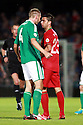 SERIES OF THREE IMAGES  Northern Ireland's Gareth McAuley confronts Portugal's  Helder Postiga, resulting in Postiga head butting McAuley and getting a red card and being sent off during the first half a World Cup Qualifier in Belfast, Friday September 6th, 2013.  Photo/Paul McErlane