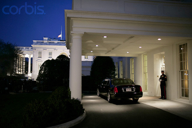 04 Jan 2007, Washington, DC, USA --- A United States Marine stands guard at the diplomatic entrance of the West Wing, near German Chancellor Angela Merkel's limousine. Merkel was meeting with President Bush in the Oval Office at the White House in Washington. --- Image by © Brooks Kraft/Corbis