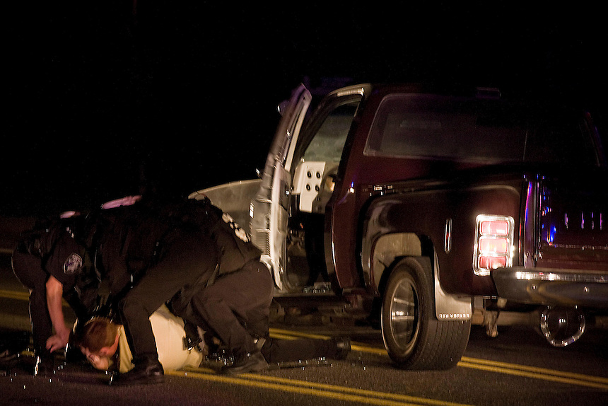 A man was removed from a truck after a pursuit that crossed the long bridge and ended near Alder and Division Streets in Sandpoint around 9 p.m. on Tuesday, September 14. <br /> (MATT MILLS MCKNIGHT/2010).