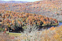 Stock photo -Grandfather mountain lake surrounded by hills covered in fall color trees, near Lindville, North Carolina, America.
