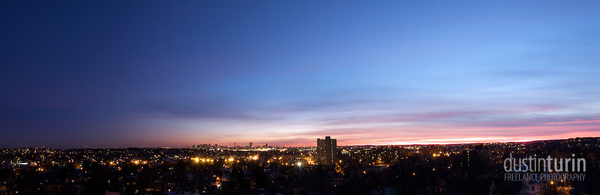 Sunset over Boston as seen from a hilltop north of the city.