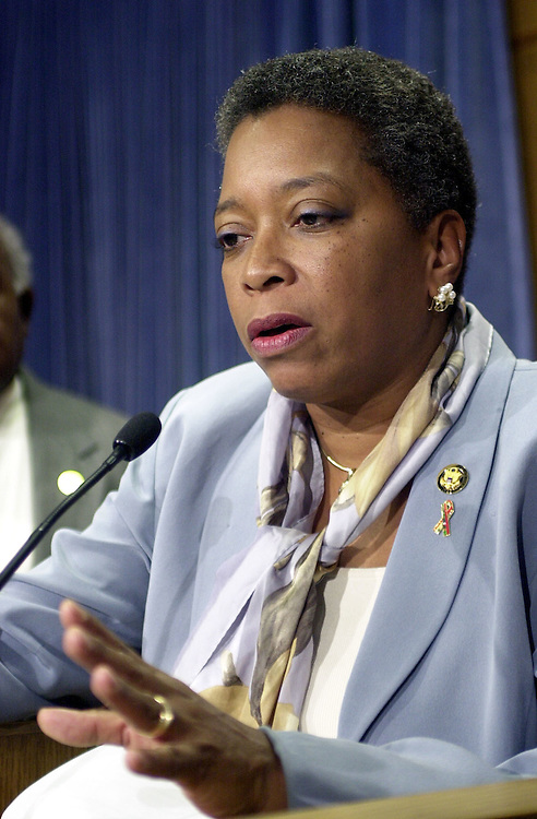 13cbc030801 -- Rep. Donna Christian-Christensen, D-VI, answers questions with the Congressional Black Caucus at a press conference opposing the President's tax plan.