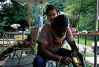 """Lucious Thompson, who lives in nearby Tom Biggs Hollow, joined Kentuckians for the Commonwealth when he found his land disrupted from above. """"There's good mining and there's bad mining,"""" Mr. Thompson said. """"Mountaintop removal takes the coal quick, 24 hours every day, making my streams disappear, with the blasting knocking a person out of bed and the giant 'dozers beep-beeping all night so you cannot sleep."""" <br /> <br /> Mr. Thompson spoke with the authority of a retired underground miner. Underground miners led quieter, more pastoral lives above harsh, deep workplaces that were far out of sight. Now, the hollow dwellers have become witnesses more than miners as a fast-moving, high-volume process uses mammoth machinery to decapitate the coal-rich hills."""