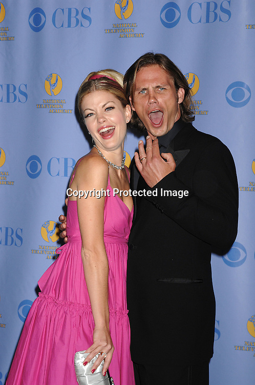 Bree Williamson and Forbes March..posing for photographers in the Press Room at The 34th Annual Daytime Emmy Awards on June 15,2007 at The ..Kodak Theatre in Hollywood, California. ..Robin Platzer, Twin Images......212-935-0770