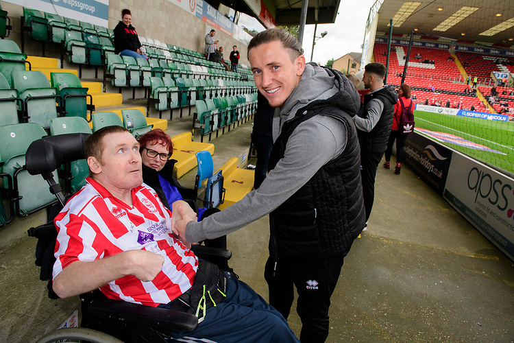 Lincoln City's Aaron Lewis with fans prior to the game<br /> <br /> Photographer Chris Vaughan/CameraSport<br /> <br /> The EFL Sky Bet League One - Lincoln City v Sunderland - Saturday 5th October 2019 - Sincil Bank - Lincoln<br /> <br /> World Copyright © 2019 CameraSport. All rights reserved. 43 Linden Ave. Countesthorpe. Leicester. England. LE8 5PG - Tel: +44 (0) 116 277 4147 - admin@camerasport.com - www.camerasport.com