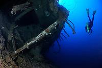 Scuba diver swims around nearly over turned ship wreck Mairi Bahn, aka Windjammer, Bonaire, Netherlands Antilles, Caribbean, Atlantic