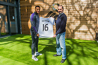 (L-R) Martin Olsson with club sponsor, photographer Dimitris Legakis at The Fairwood training Ground, Swansea, Wales, UK. Tuesday 25 April 2017
