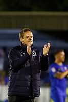 AFC Wimbledon manager, Neal Ardley applauds the fans at the end of the Sky Bet League 1 match between AFC Wimbledon and MK Dons at the Cherry Red Records Stadium, Kingston, England on 22 September 2017. Photo by Carlton Myrie / PRiME Media Images.