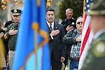 From left, Sheriff Ken Furlong, Gov. Brian Sandoval and Kevin Howell say the Pledge of Allegiance during a ceremony unveiling a freeway sign dedicating I-580 in honor of Carson City Sheriff's Deputy Carl Howell at the Nevada Law Enforcement Officers Memorial in Carson City, Nev., on Tuesday, Dec. 8, 2015. <br /> Photo by Cathleen Allison/Nevada Photo Source