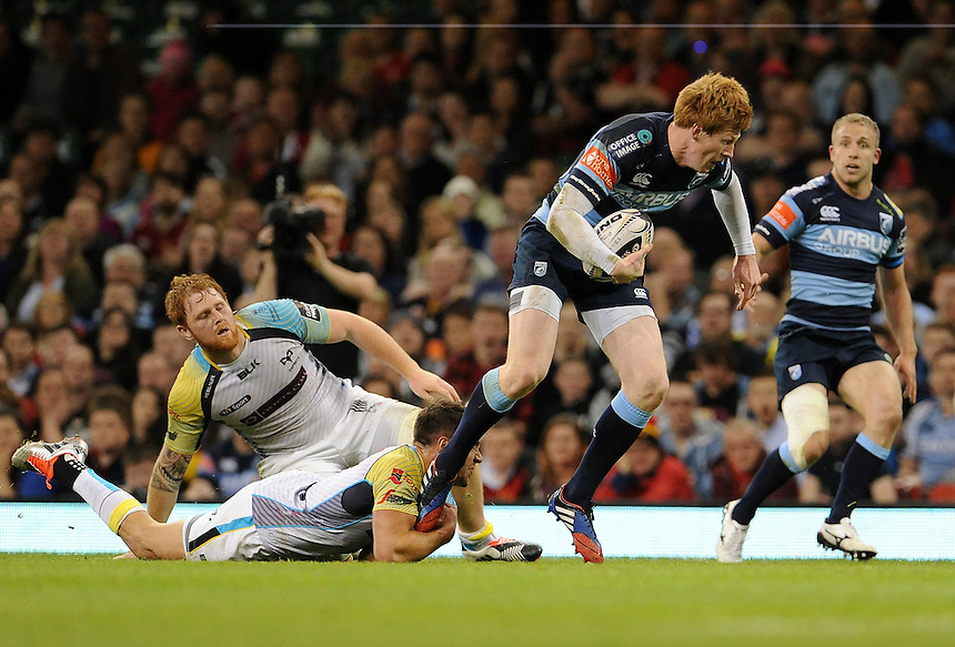 Cardiff Blues' Rhys Patchell is tackled by Ospreys' Rhys Webb<br /> <br /> Photographer Ian Cook/CameraSport<br /> <br /> Rugby Union - Guinness PRO12 - Saturday 25th April 2015 - Cardiff Blues v Ospreys - Millennium Stadium - Cardiff<br /> <br /> &copy; CameraSport - 43 Linden Ave. Countesthorpe. Leicester. England. LE8 5PG - Tel: +44 (0) 116 277 4147 - admin@camerasport.com - www.camerasport.com