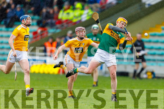 Kerry's Michael O'Leary attempts to clear the ball away as Eoghan Campbell of Antrim is about to hook him, in the NHL Div 2A hurling game in Austin Stack Park on Sunday.