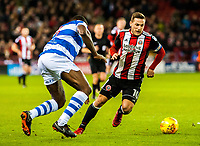 Sheffield United's forward Billy Sharp (10) takes on Queens Park Rangers defender Nedum Onuoha (5) during the Sky Bet Championship match between Sheff United and Queens Park Rangers at Bramall Lane, Sheffield, England on 20 February 2018. Photo by Stephen Buckley / PRiME Media Images.