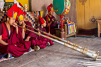 Prakhar Lhakhang, Bumthang, Bhutan.  Buddhist Monks Playing the Dungchen (Long Trumpet).