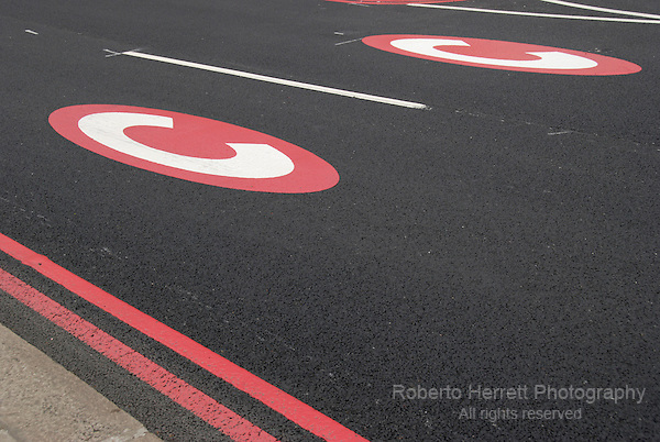 Congestion charge sign and double red line on road, London