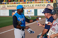 Tampa Tarpons center fielder Estevan Florial (34) signs autographs for fans before a game against the Lakeland Flying Tigers on April 6, 2018 at Publix Field at Joker Marchant Stadium in Lakeland, Florida.  Lakeland defeated Tampa 6-5.  (Mike Janes/Four Seam Images)
